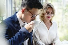 Business people drinking some coffee. Together at cafe Stock Photos
