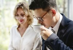 Business people drinking some hot beverage royalty free stock photo