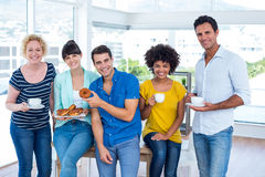 Business people eating donuts and drinking Stock Photos