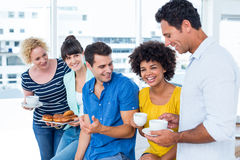 Business people eating donuts and drinking Royalty Free Stock Photo