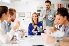 Business people eating in office. Business people eating meals in modern office royalty free stock image