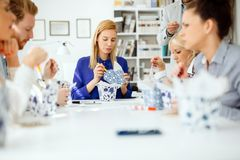Business people eating in office. Business people eating meals in modern office stock photo