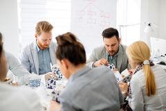 Business people eating in office. Business people eating meals in office stock images