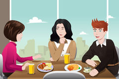 Business people eating together Stock Photos