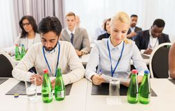 Businesspeople with papers at conference Royalty Free Stock Photo