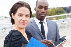 Business people and electronic tablet Stock Image