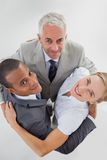 Business people embracing together Stock Photography