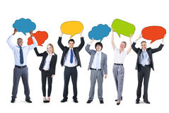 Business People and Empty Speech Bubbles Stock Images