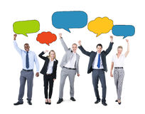 Business People and Empty Speech Bubbles Stock Image