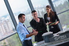 Business people and engineers on meeting Royalty Free Stock Photos