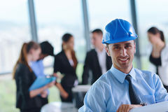 Business people and engineers on meeting Stock Image