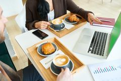 Business People Enjoying Coffee during Meeting stock photo