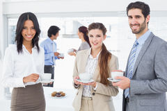 Business people enjoying their drinks Stock Photos