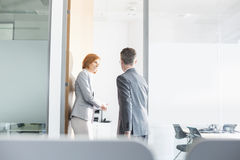 Business people entering into conference room Stock Images