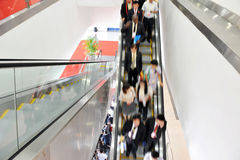 Business people on the escalator Royalty Free Stock Photos