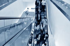 Business people on the escalator Stock Photography