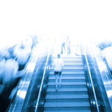 Business people on escalator Stock Photos