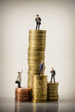 Business people and euro coin piles Stock Images