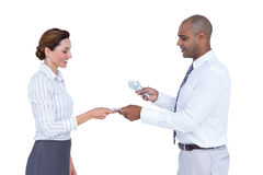 Business people exchanging bank notes royalty free stock photo
