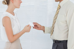 Business people exchanging business card. In bright office Stock Photos