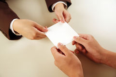 Business people exchanging card Stock Images