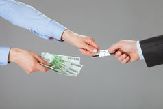 Business people exchanging credit card and money Stock Image