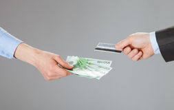 Business people exchanging credit card and money Royalty Free Stock Photography