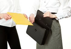 Business people exchanging documents Stock Images