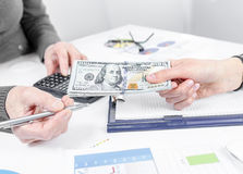 Business people exchanging dollar banknotes. Closeup shot of hands royalty free stock photo