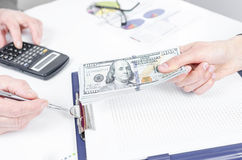 Business people exchanging dollar banknotes. Closeup shot of hands stock photography
