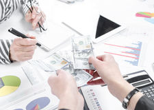Business people exchanging dollar banknotes. Closeup shot of hands royalty free stock photos