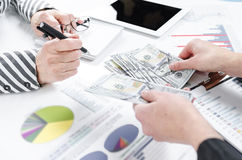 Business people exchanging dollar banknotes. Closeup shot of hands stock image