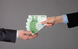 Business people exchanging euro banknotes Royalty Free Stock Image