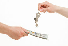 Business people exchanging keys and money. White background Stock Photo