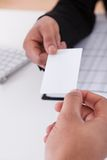 Business people exchanging visiting card Stock Photos