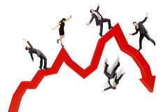 Business people falling from arrow Stock Photography
