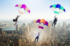 The business people falling down on parachutes Royalty Free Stock Images