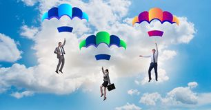 The business people falling down on parachutes Royalty Free Stock Photo