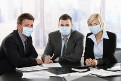 Business people fearing swineflu virus Stock Photos