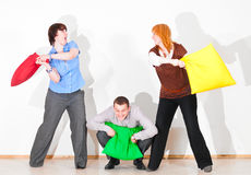 Business people are fighting with pillows Royalty Free Stock Image