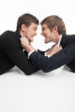 Business people fighting. stock photography