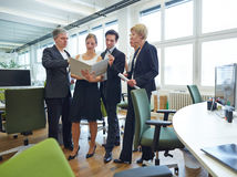 Business people with files in office Stock Images