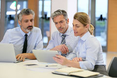 Business people on financial meeting Stock Images