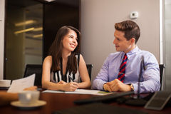 Business people flirting in the office Stock Photography