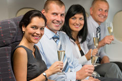Business people flying airplane drink champagne royalty free stock images
