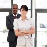 Business people with folded arms Stock Photos