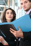 Business People with Folders Stock Image