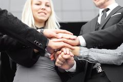 Business people folding their hands together.concept of teamwork. Business people folding their hands together. concept of teamwork Stock Photo