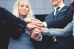 Business people folding their hands together.concept of teamwork. Business people folding their hands together. concept of teamwork Royalty Free Stock Photography