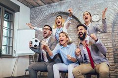Business people or football fans watching soccer on tv and celebrating victory. Friendship, sports and entertainment concept. Happy business people or football stock photos
